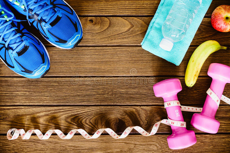 Fitness, healthy, active lifestyles Concept, dumbbells, sport. Fitness, healthy and active lifestyles Concept, dumbbells, sport shoes, bottle of waters, bananas royalty free stock image