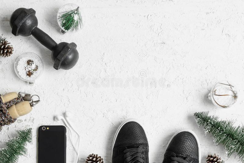 Fitness and Healthy Christmas sport composition. Overhead shot of sport shoes, dumbbells, skipping rope and Christmas ornaments. Special for Merry christmas and royalty free stock photos
