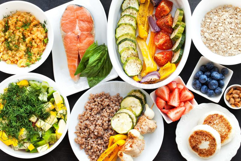 Fitness healthy food. Health & Fitness Food in lunch boxes. Set meal for the whole day royalty free stock images