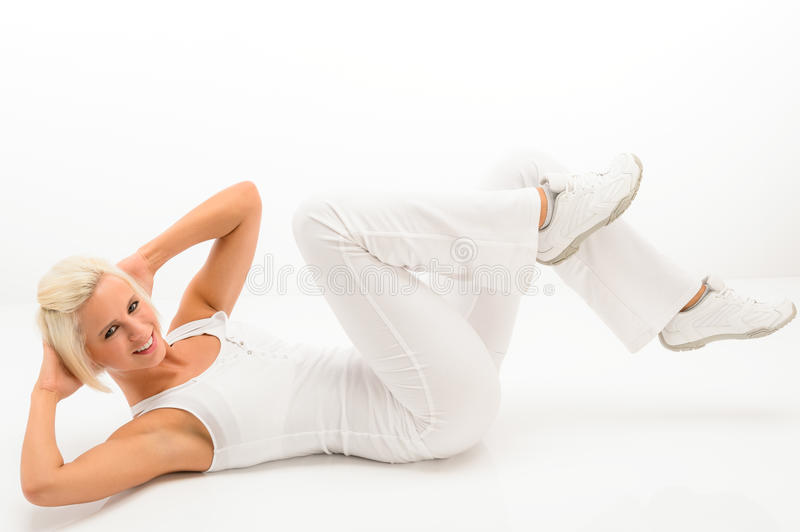Fitness instructor exercise abdominals white floor stock photos