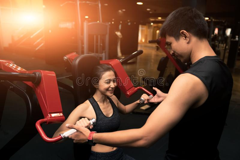 Fitness instructor with girl on training in fitness center royalty free stock photos