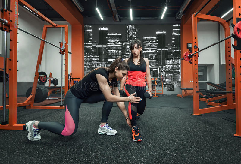 Fitness instructor in the gym royalty free stock photo