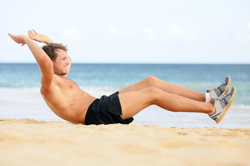 Download Fitness Man Doing Crunches Sit-ups On Beach Stock Image - Image: 31881001