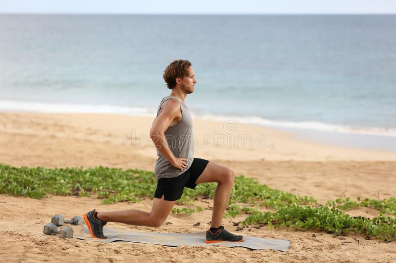 Fitness man doing lunges leg exercise lunge exercising legs. Male fitness model doing alternating bodyweight Lunge workout stock photography