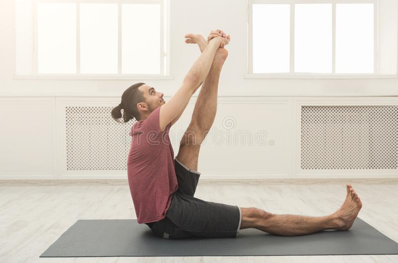 Fitness man at legs stretching training stock photos