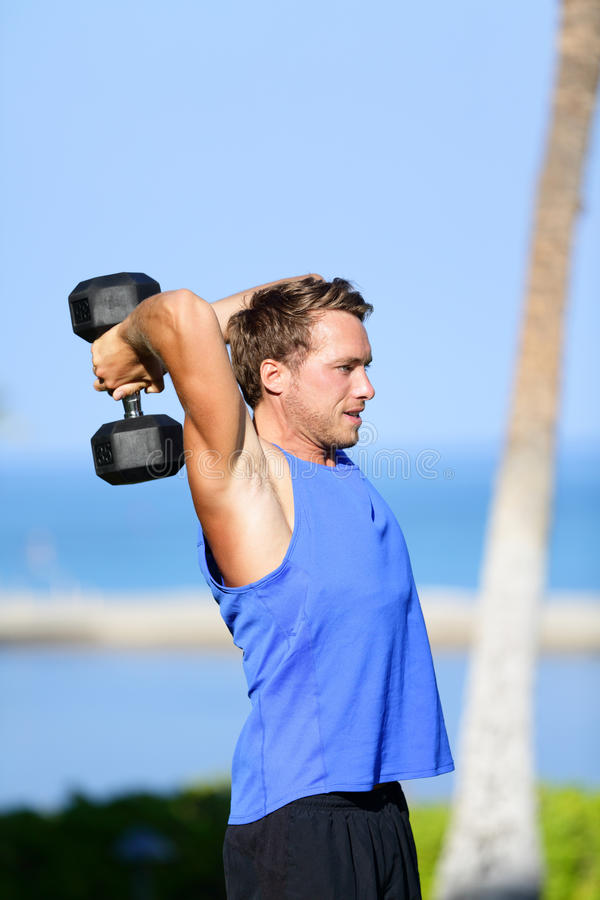 Fitness man lifting dumbbells training triceps
