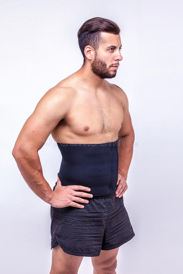 Fitness man in orthopedic belt stock photography