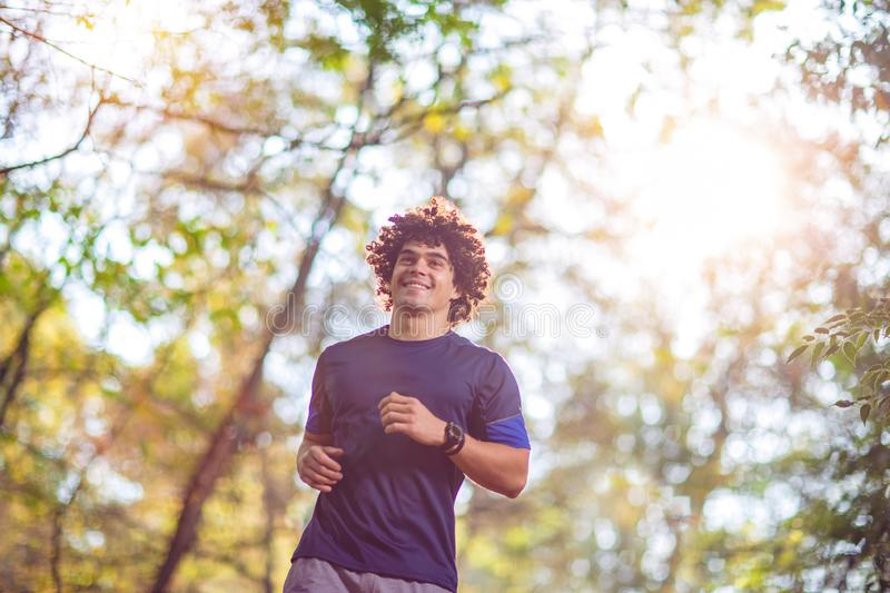 Fitness Man running at the nature- fitness, sport, training and stock photo
