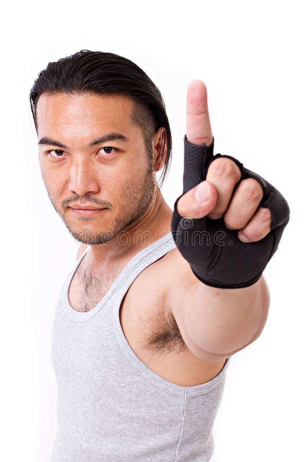 Fitness man showing number 1 hand gesture royalty free stock images