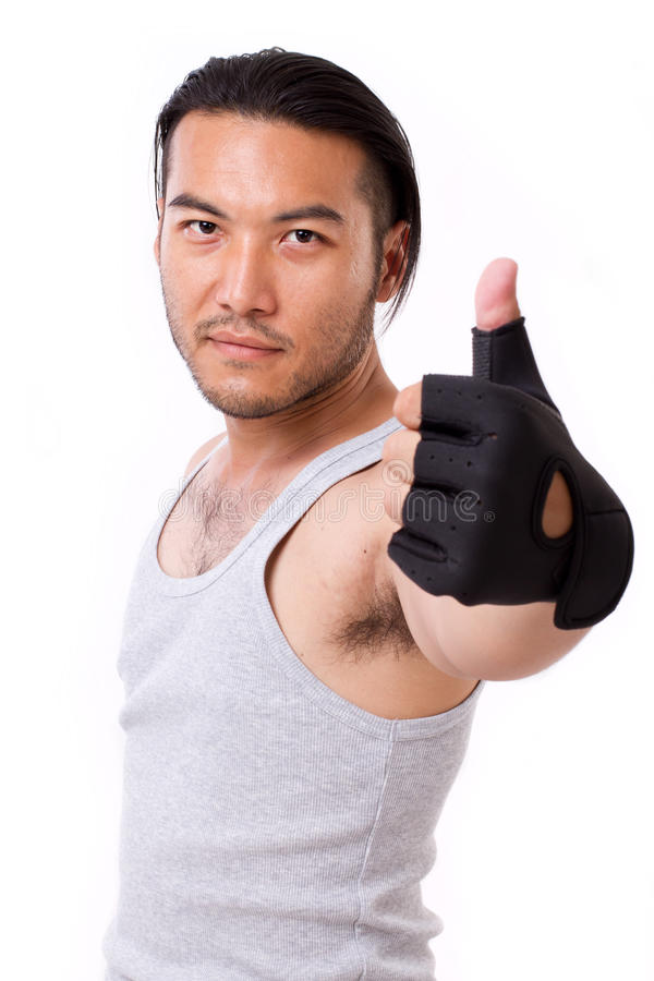Fitness man showing thumb up gesture stock images
