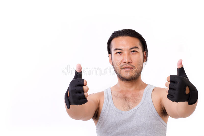 Fitness man showing thumb up gesture stock image