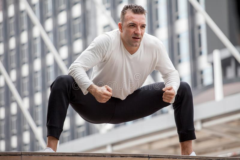 Fitness man stretching legs in urban city .sport,exercise,workout,training stock photos
