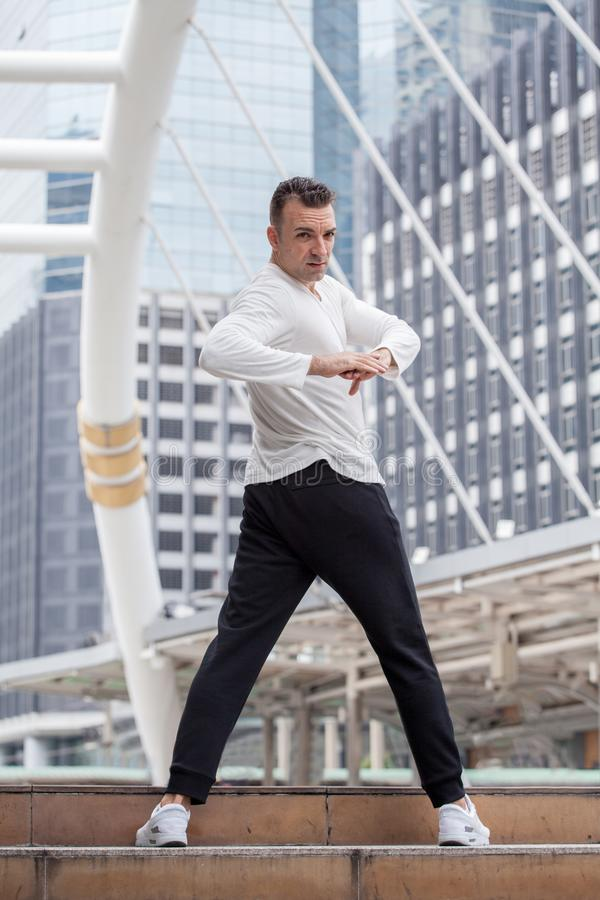 Fitness man stretching in urban city .sport,exercise,workout,training royalty free stock photography