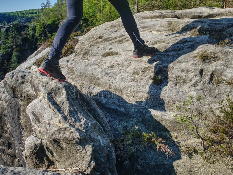 Fitness man trail runner running to rocky mountain top royalty free stock images