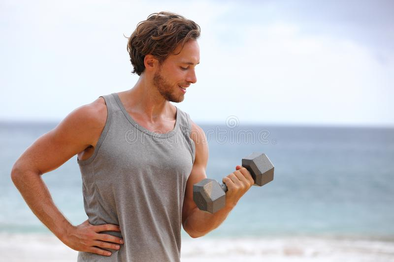 Fitness man training bicep curl arm exercise workout exercising arms with dumbbell weight. Active healthy lifestyle royalty free stock photo