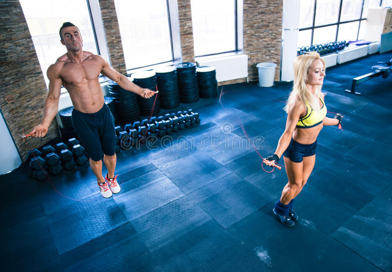 Fitness man and woman workout with jumping rope royalty free stock photography