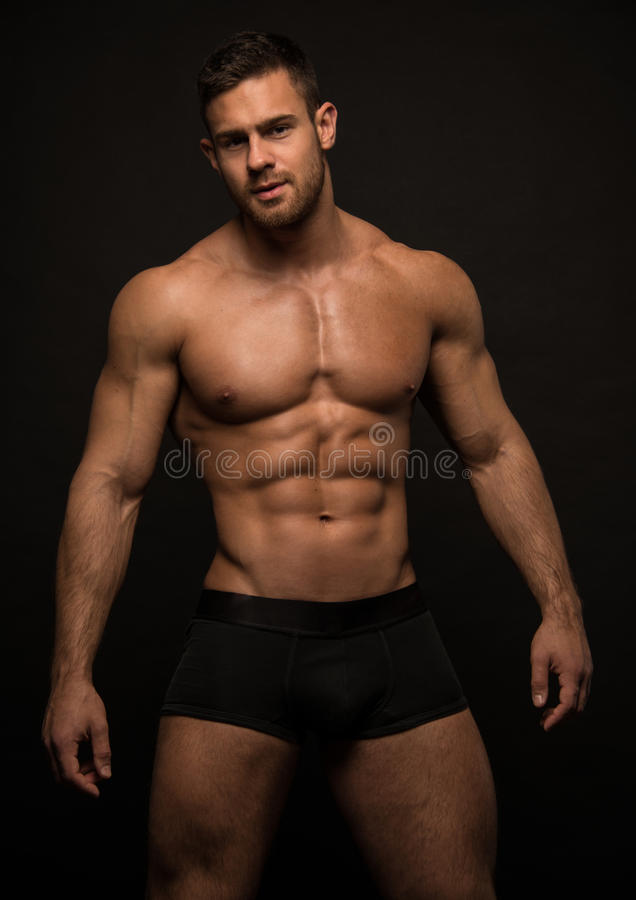 Fitness model. Muscled male model in studio royalty free stock photos