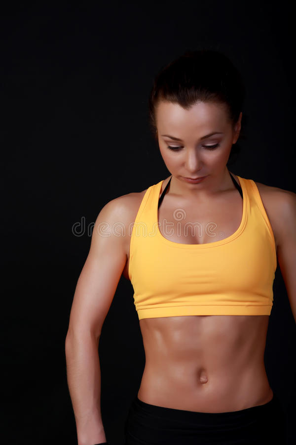 Fitness model posing. Young attractive female fitness model posing stock photo