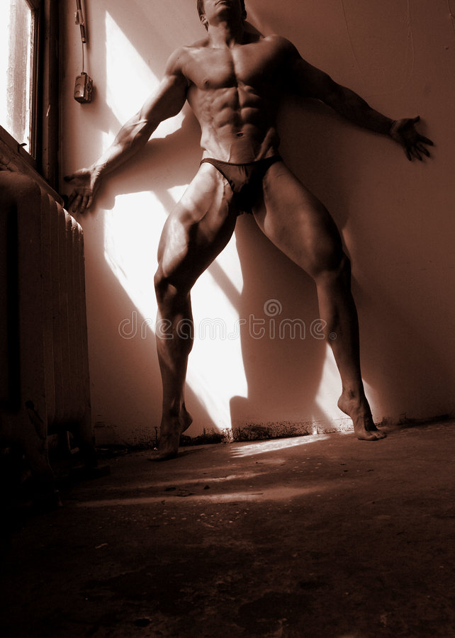 Fitness model in a shaft of light royalty free stock image