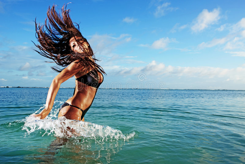 Fitness Model Splashing in Ocean stock photography