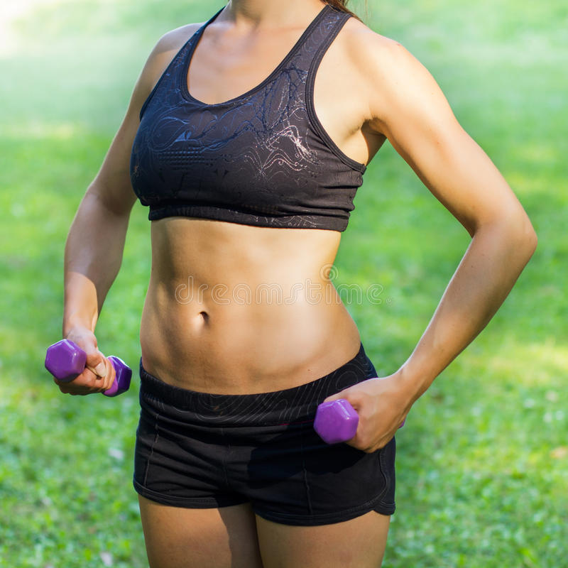 Fitness Muscular Female Body royalty free stock photo