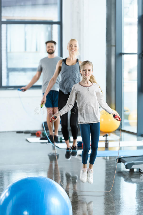 Fitness people exercising with skipping ropes at sports center stock images