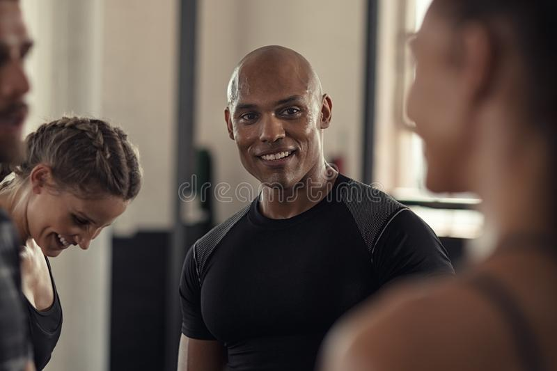 Fitness people talking in gym stock images