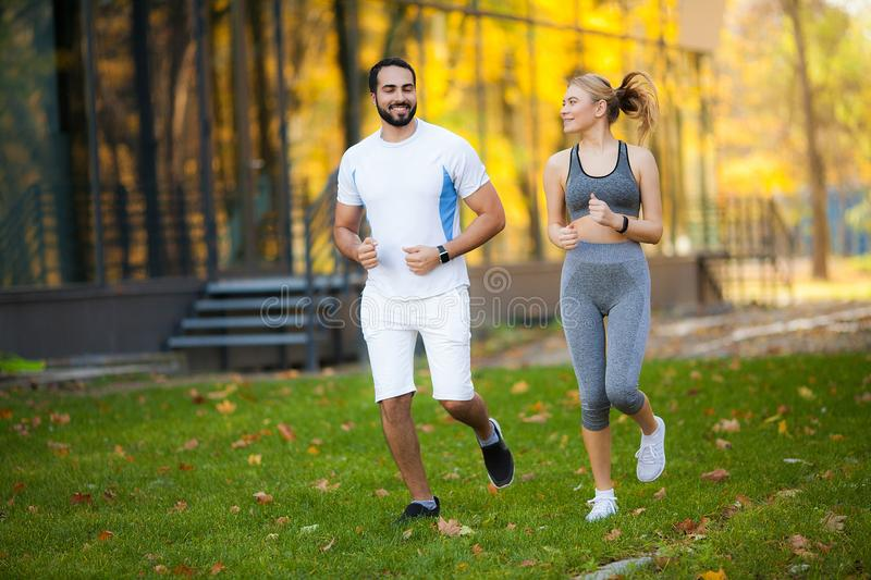 Fitness. Personal Trainer Takes Notes While Woman Exercising Outdoor royalty free stock photography