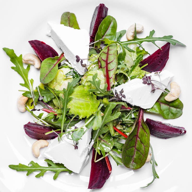 Fitness Salad with Arugula and Goat Cheese royalty free stock image