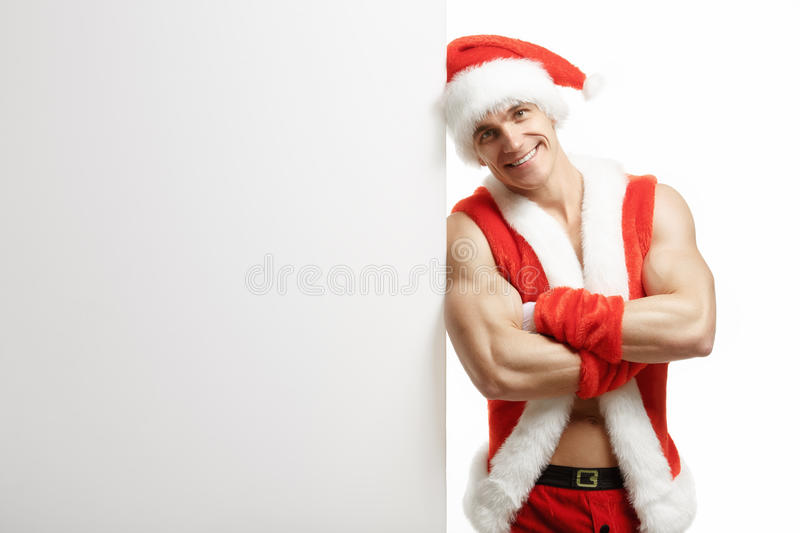 Fitness Santa Claus with a banner sales stock photos