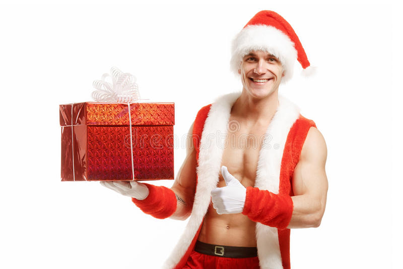 Fitness Santa pointing like a red box royalty free stock images