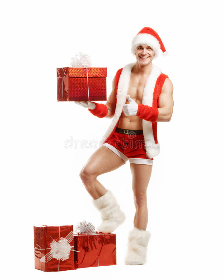 Fitness Santa pointing like a red box royalty free stock photography