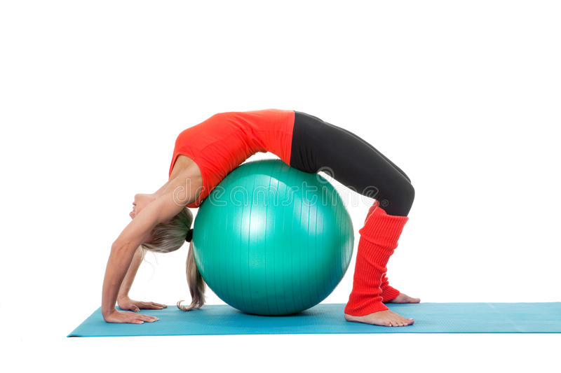 Fitness series: woman and exercise ball royalty free stock photos