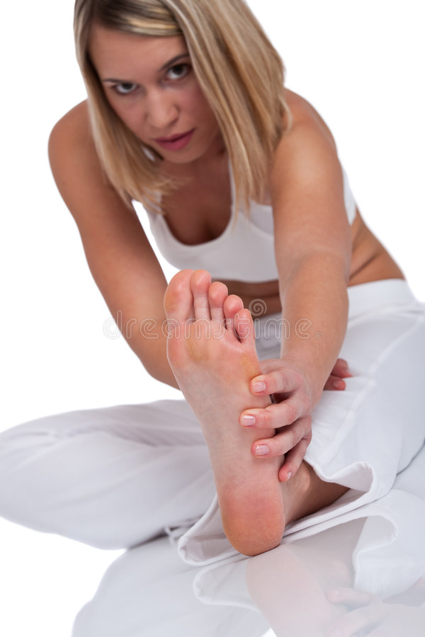 Fitness series - Young woman in white clothes. Young woman in fitness clothes, focus on feet stock photo
