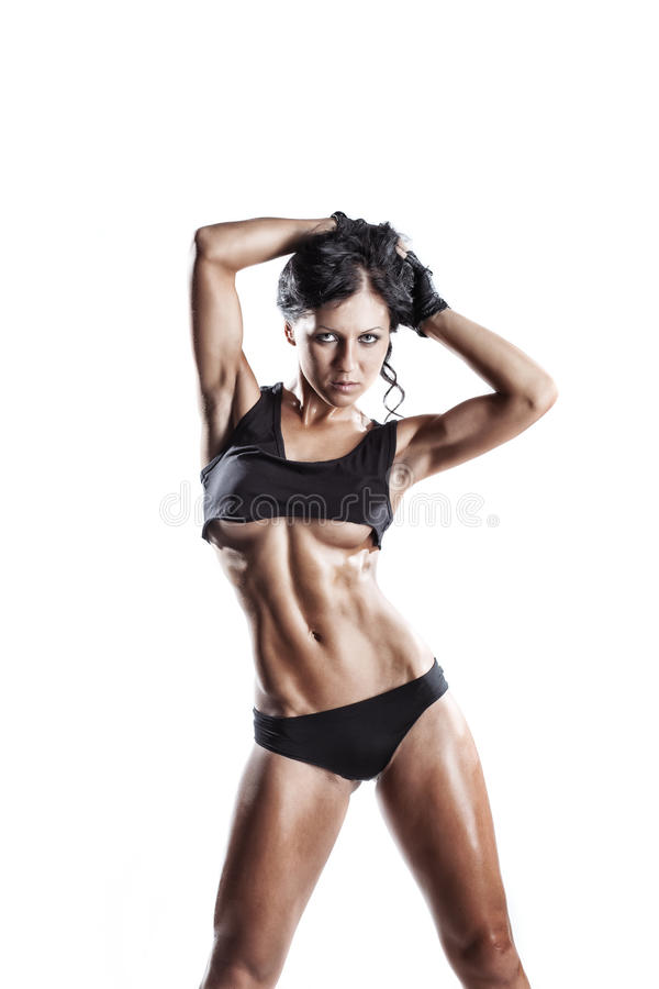 Fitness woman in sport wear with perfect fitness body posing. Young fitness girl posing isolated over white. Fitness woman in sport wear with perfect fitness royalty free stock photo