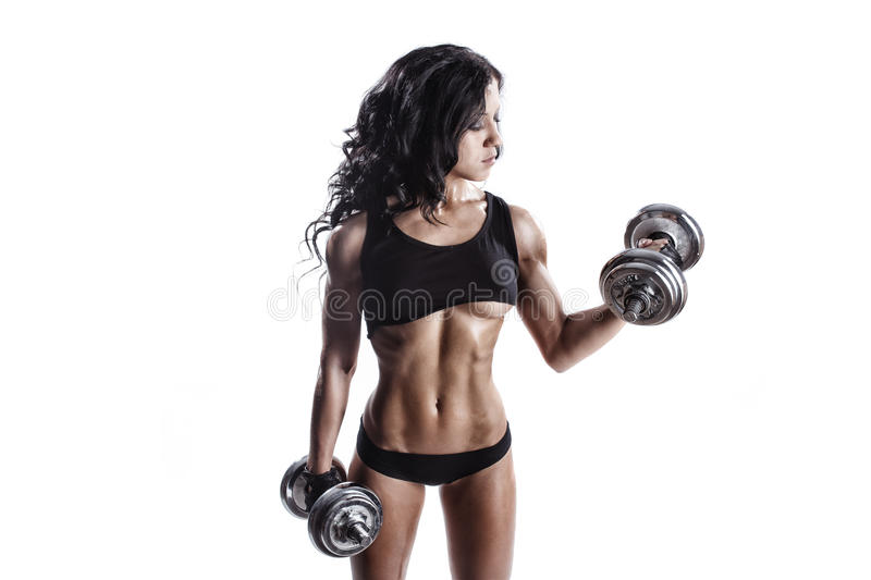 Fitness young woman in sport wear with perfect fitness body training with dumbbells stock images