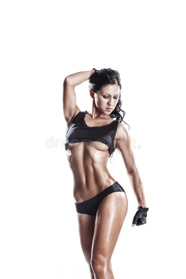 Fitness young woman in sport wear with perfect fitness body training with dumbbells. Young muscled fitness brunette girl back posing isolated over white royalty free stock photo