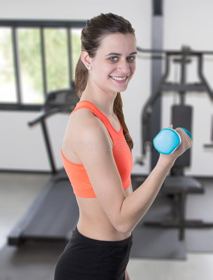 Fitness slim woman in the gym equipment for training exercise stock photo