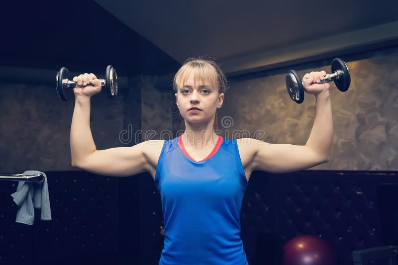 Fitness. Sport concept. Workout. Blonde girl holds black dumbbells. Fitness girl. Healthy lifestyle. Training. Workout. Woman hold. Ing dumbbell. Blonde girl stock photos