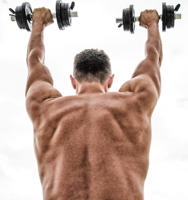 Fitness and sport equipment. Healthy lifestyle. athletic body. Dumbbell gym. man sportsman weightlifting. steroids royalty free stock photos