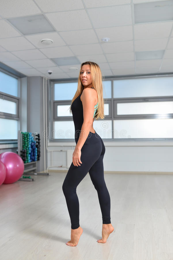 Fitness, sport, exercising lifestyle - woman in black bodysuit posing at gym.  stock images