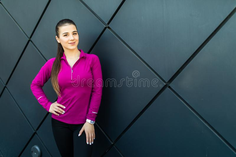 Fitness sport girl in sportswear doing fitness exercise in the street, outdoor sports, urban style. Fitness sport girl in sportswear doing yoga fitness exercise royalty free stock photography