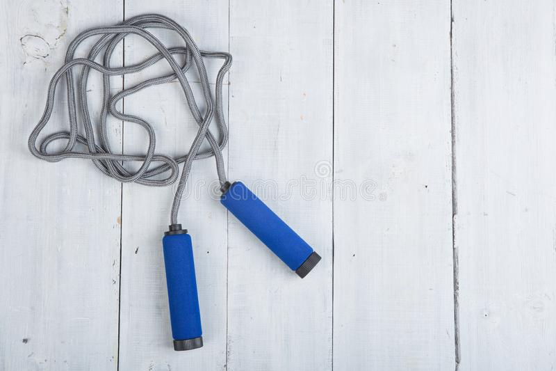 Fitness/sport and healthy lifestyle concept - Jumping/skipping rope with blue handles royalty free stock photo
