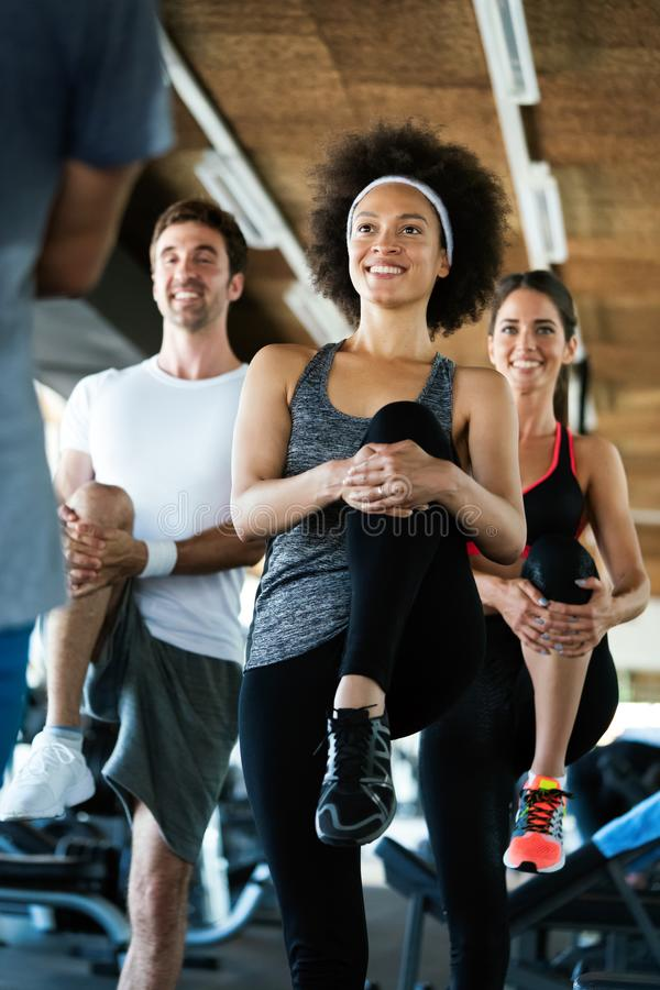 Fitness, sport, healthy and lifestyle concept. Smiling african american woman in gym royalty free stock photos