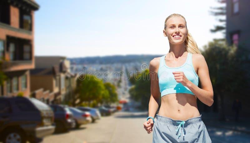 Smiling woman running at san francisco city royalty free stock photo