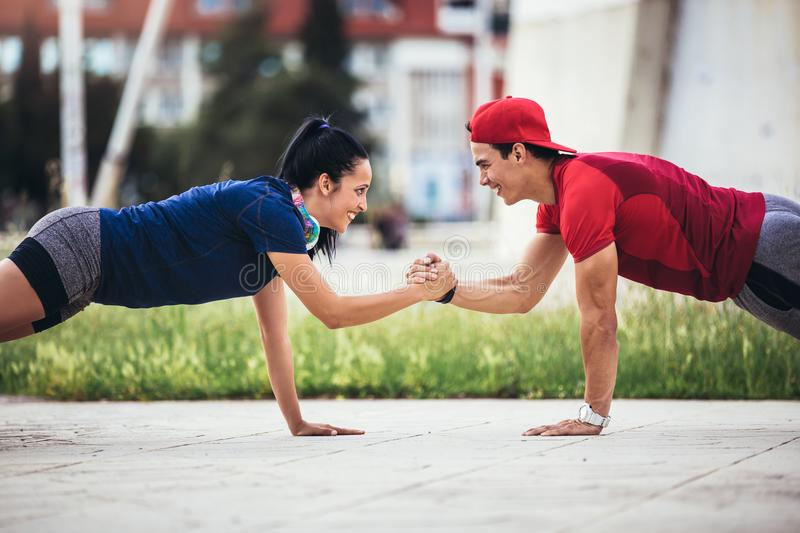 Man and woman exercising outdoors royalty free stock images