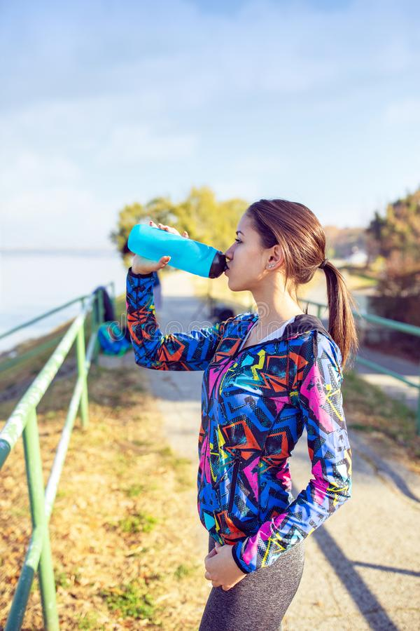 Fitness, sport, training and lifestyle concept -Woman drinking stock images