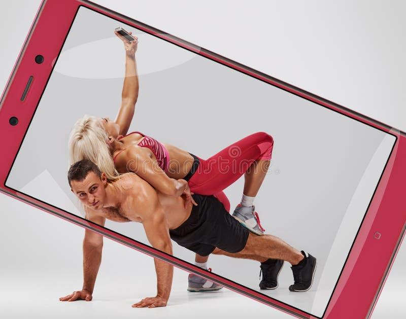 Man doing push ups but woman selfie royalty free stock photo