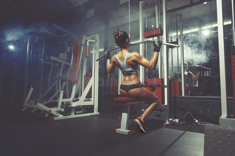 Fitness sport woman lifts in the gym royalty free stock images