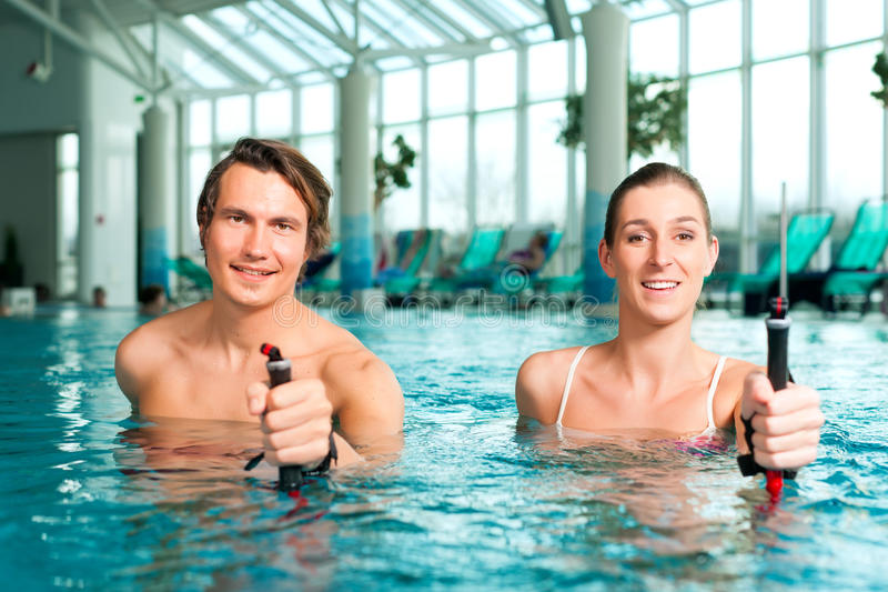 Fitness - sports and gymnastics under water in spa